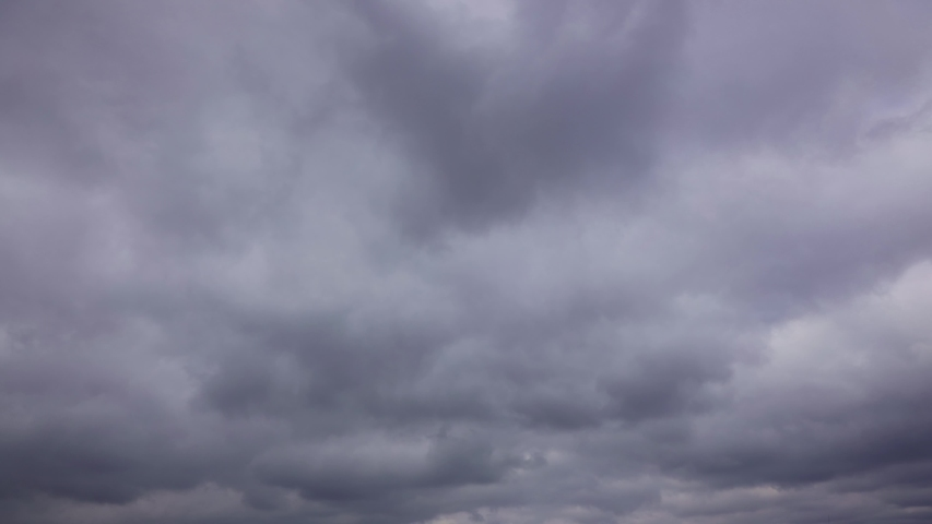 Timelapse, rain clouds sweep through the sky quickly. Faster video cloudy weather and strong wind | Shutterstock HD Video #1055388038