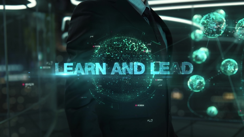 Businessman with Learn and Lead hologram concept Royalty-Free Stock Footage #1055389487