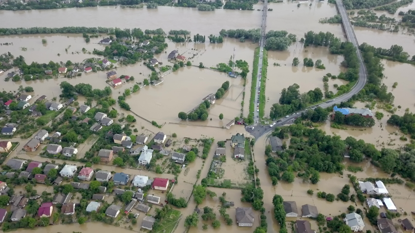 Flooded neighborhood street. Major flooding leaves city, underwater, entire community. Homes, houses overflowing water, insurance needed. Rescue teams helping people Ivano-frankivsk Galych, Ukraine