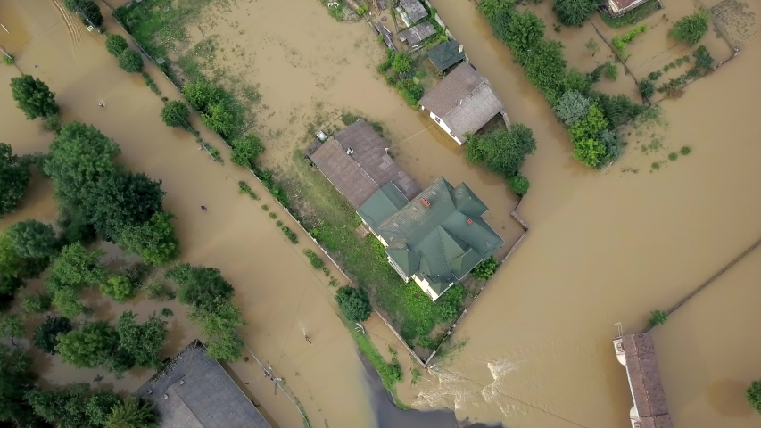 Flooded neighborhood street. Major flooding leaves city, underwater, entire community. Homes, houses overflowing water, insurance needed. Rescue teams helping people Ivano-frankivsk Galych, Ukraine