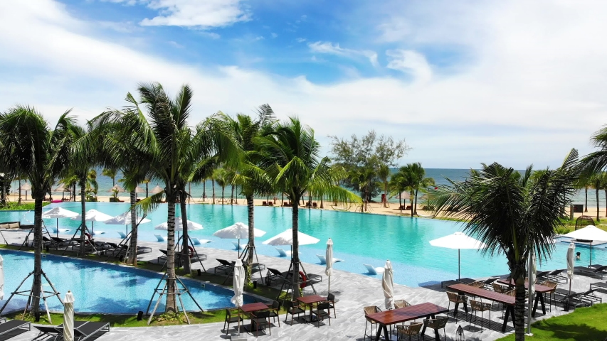 Aerial view of Swimming pool in the resort at Phu Quoc, Vietnam. Romantic beach from the top video concept with beach resorts
