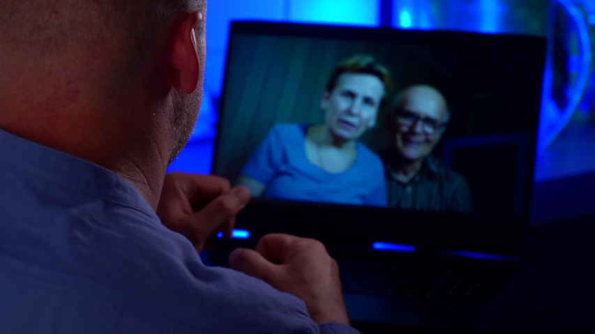 Adult man is chatting with his elderly parents by video call by laptop, internet communications   Shutterstock HD Video #1055391710