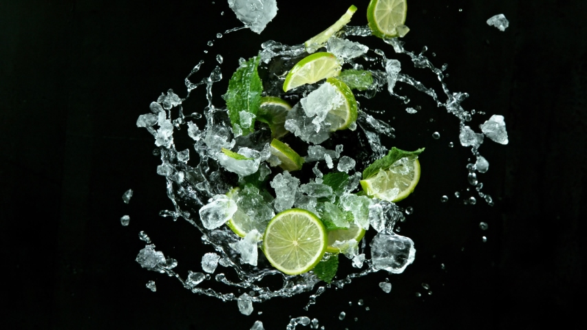Refreshing mojito cocktail vortex on black stone table, slow motion filmed on high speed cinematic camera.