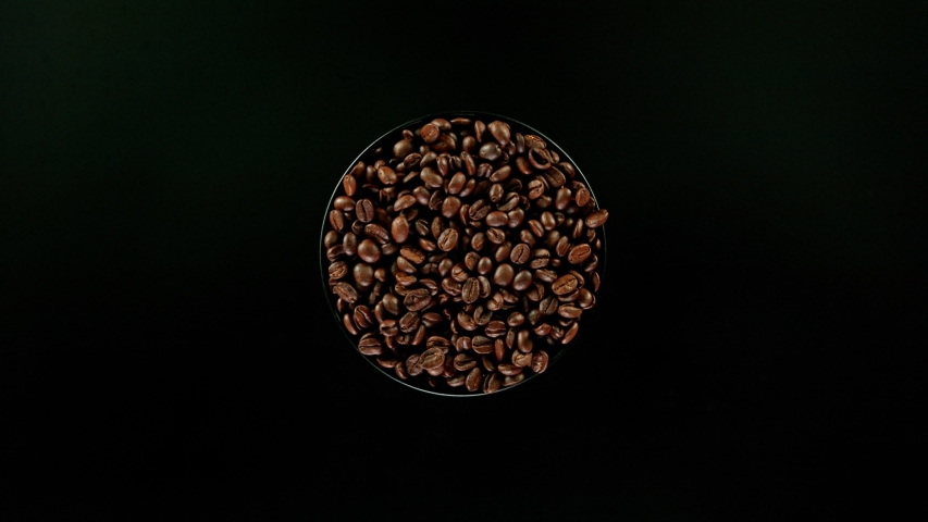 Coffee beans explosion, super slow motion, top view. | Shutterstock HD Video #1055391986