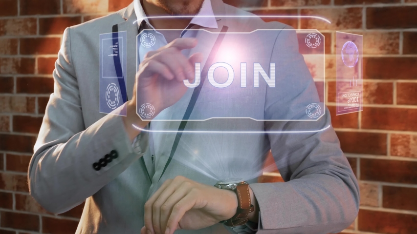 Unrecognizable businessman activates conceptual HUD holograms on smartwatch with text Join. Man in jacket with holographic technology on wristwatch on background of brick wall   Shutterstock HD Video #1055392472