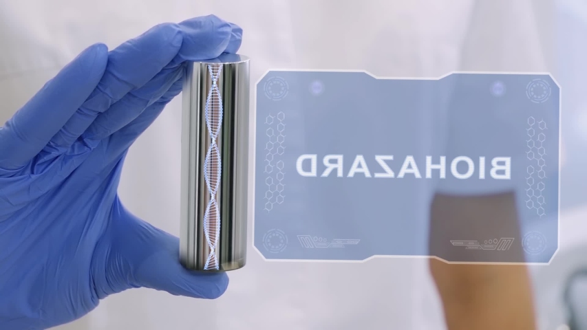 Hand in blue medical glove with a futuristic hud hologram with text Biohazard. Medical concept of the technology of the future. Doctor with Futuristic Holographic Gadget   Shutterstock HD Video #1055392478