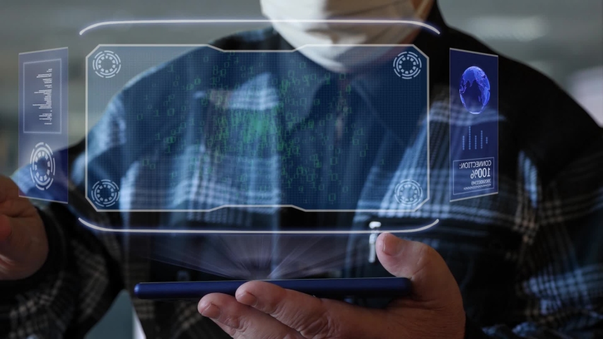 Unrecognizable elderly man in a protective mask interacts with HUD holograms on a smartphone with text Risk. Old man in a plaid shirt with a holographic screen on a blurred background   Shutterstock HD Video #1055392481