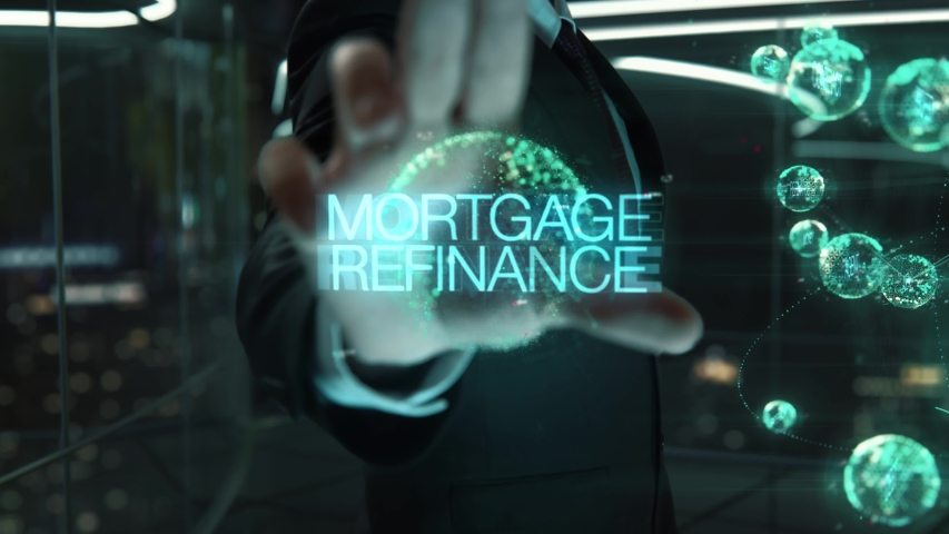 Businessman with Mortgage Refinance hologram concept   Shutterstock HD Video #1055394041