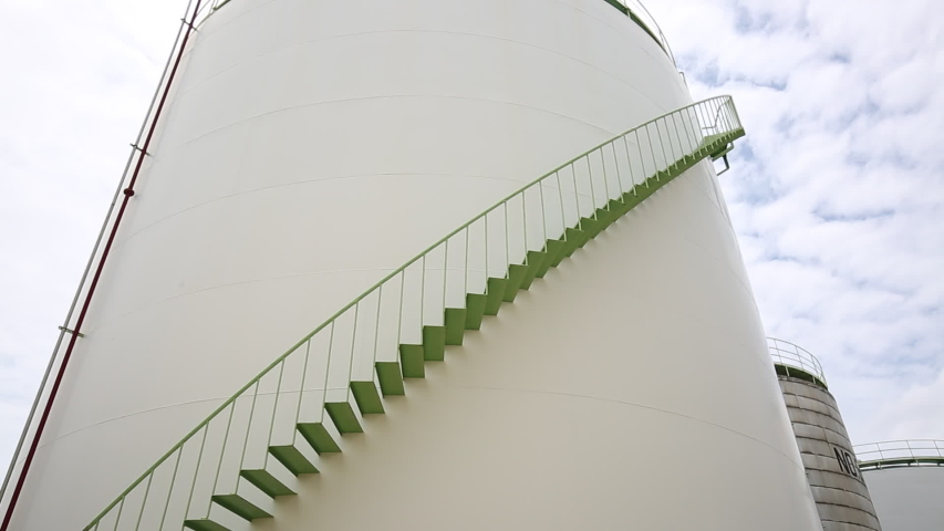 Male worker climb up and down inside the stairway storage tank visual inspection tank chemical  | Shutterstock HD Video #1055398433
