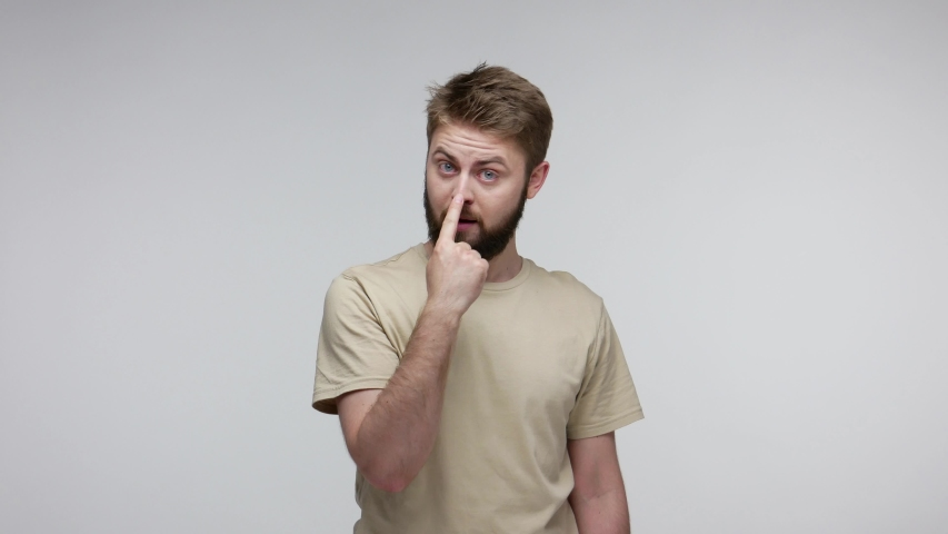 You lie to me! Bearded man suspecting falsehood, touching nose doing liar gesture and pointing at camera, angry about deception, distrustful communication. studio shot isolated on gray background | Shutterstock HD Video #1055413799