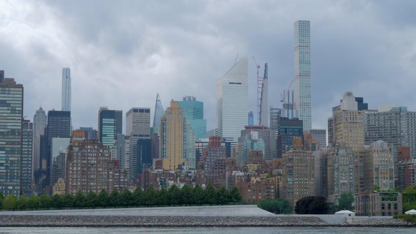 Midtown Manhattan skyline at sunrise in New York | Shutterstock HD Video #1055426165