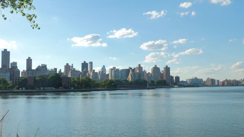 Midtown Manhattan skyline from Astoria  queens at sunrise in New York | Shutterstock HD Video #1055426342