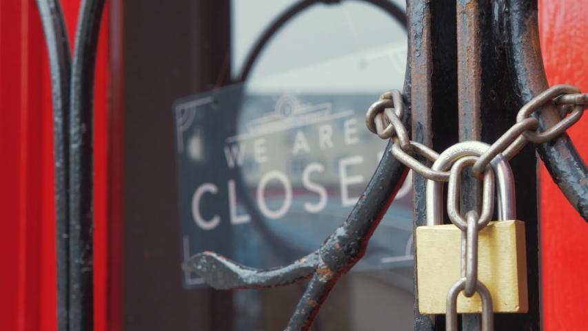 Closed restaurant sign locked entrance Corona virus disease 4K