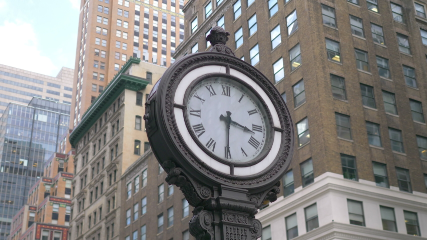 Clock On the 5th Ave in New York City in 4K Slow motion. | Shutterstock HD Video #1055431112