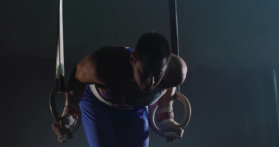 Strong Male Gymnast Performing On Stationary Gymnastic Rings Closeup Sports Center Healthy Lifestyle Effort Gymnastics Competitive Mindset Concept 4k | Shutterstock HD Video #1055432429