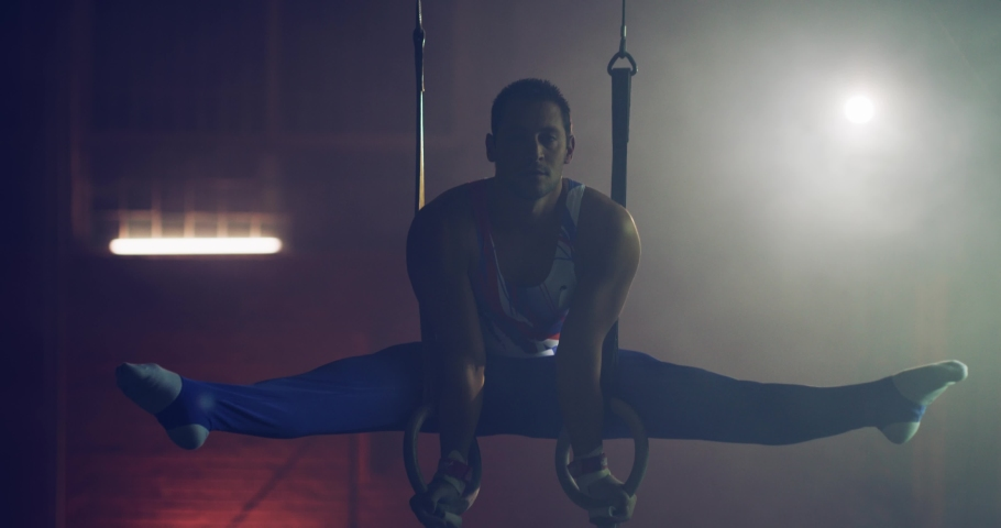Handsome Muscular Athletic Man In Gymnastics Uniform Doing Intense Workout On Gymnastic Rings Sports Center Healthy Lifestyle Effort Gymnastics Competitive Mindset Concept 4k | Shutterstock HD Video #1055432435