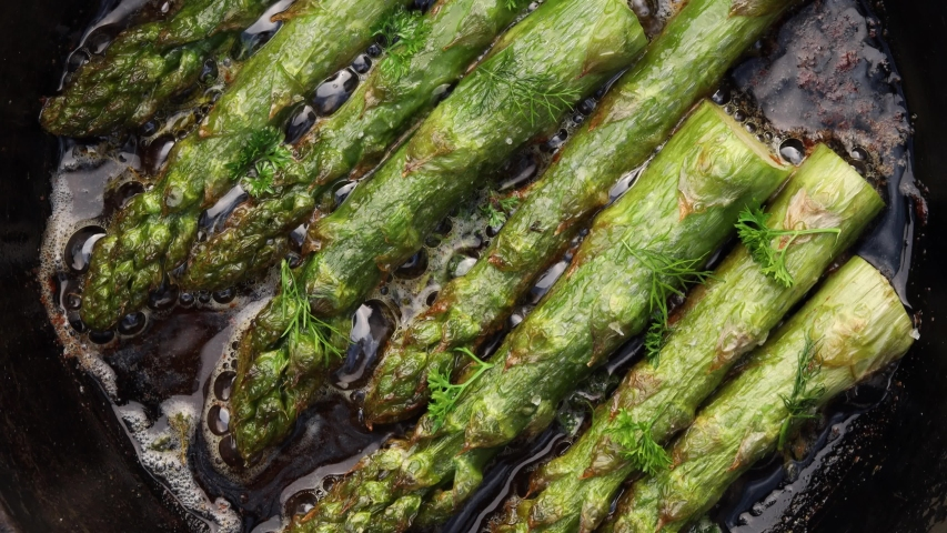 Green asparagus stewed in butter, top view