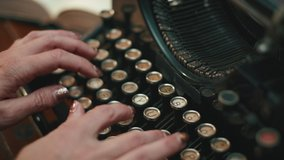 slow motion typing on a vintage Underwood typewriter. Woman types confidently on retro typewriter. Isolated clip showing typewriter strikers.