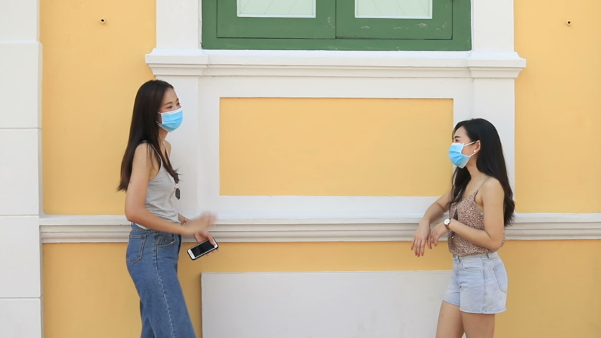 Two friends with protective masks  protect from Coronavirus COVID-19.