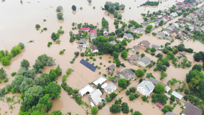 Aerial View from above on the flooded houses and the city. Flood after floods from the mountains. The houses are flooded with dirty water of the flooded river Royalty-Free Stock Footage #1055450345