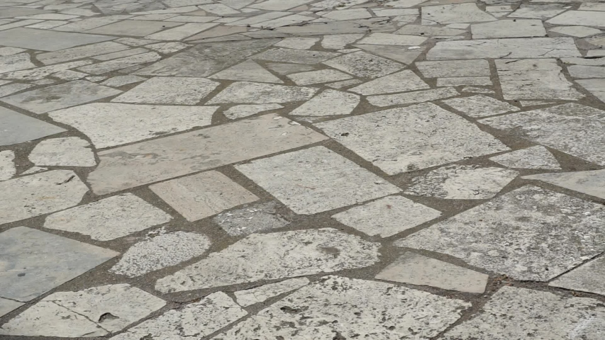 Surface of a travertine flooring with opus incertum technique | Shutterstock HD Video #1055452325