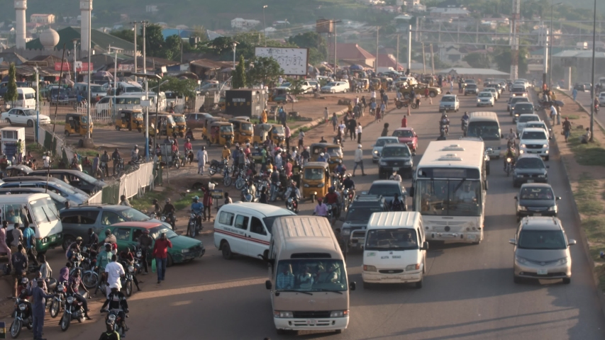 Busy street with people ,cars, trucks and Motorcycle in rush hour on a busy road in Nyanyan,Federal capital territory Abuja, Nigeria west Africa.Shot on 05/06/2020