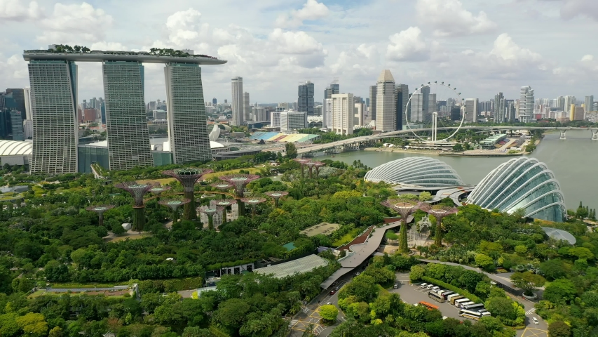 Drone Aerial view 4k Footage of Gardens By The Bay, Flying Towards Skyline Singapore. Marina Bay In Singapore.
