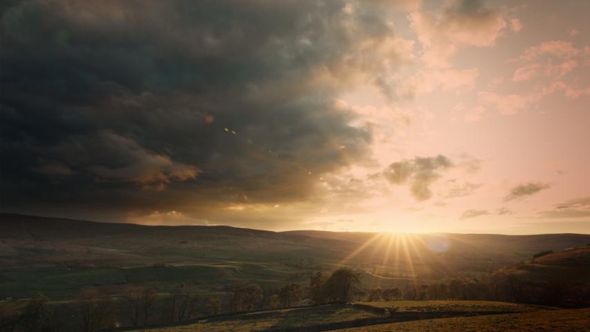 WS PAN Sun setting above fields / Kirkhaugh, | Shutterstock HD Video #1055471438