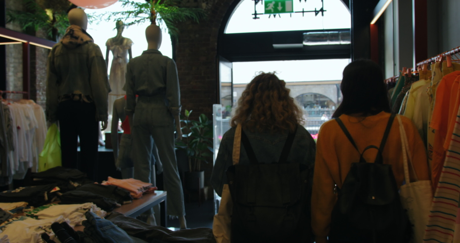 MS WS Two women walking out of boutique at King's Cross/ London, UK | Shutterstock HD Video #1055475827