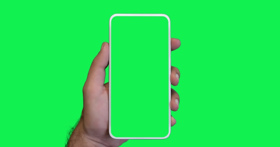 Man's hand holding a smartphone with a vertical green screen in tram chroma key smartphone technology cell phone touch message display hand with luma white and black key | Shutterstock HD Video #1055491649