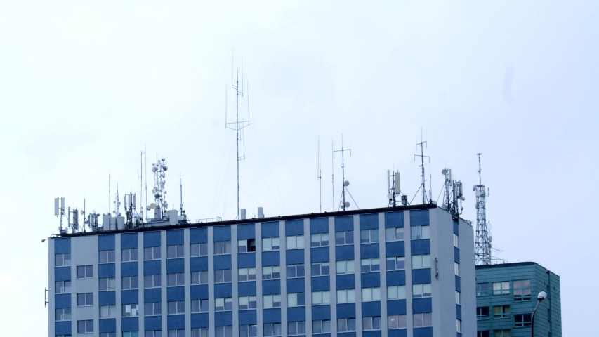 Lots of antennas on the roof on cloudy background | Shutterstock HD Video #1055497349