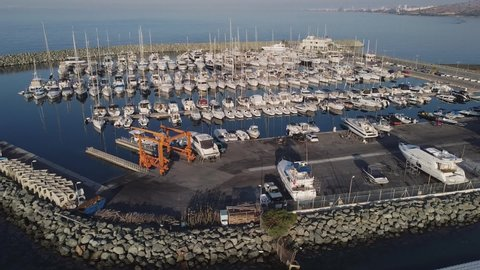 Flight of the drone over the marina at the hotel San Rafael, Limassol, Cyprus.  Early morning.