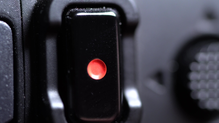 Macro shot of record button on a camera getting pressed.   Shutterstock HD Video #1055505461