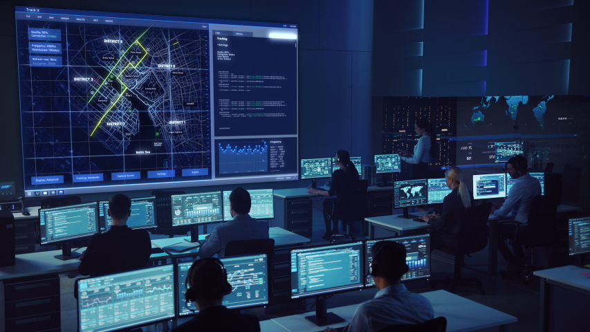 Team of Professional Computer Data Science Engineers Work on Desktops with Screens Showing Charts, Graphs, Infographics, Technical Neural Data and Statistics. Low Key Control and Monitoring Room. Royalty-Free Stock Footage #1055506811