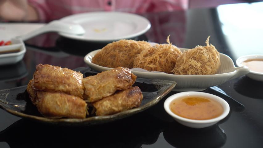 Chopsticks eating Cantonese Hong Kong style Dim Sum fried tofu and fried taro morning tea food | Shutterstock HD Video #1055507120