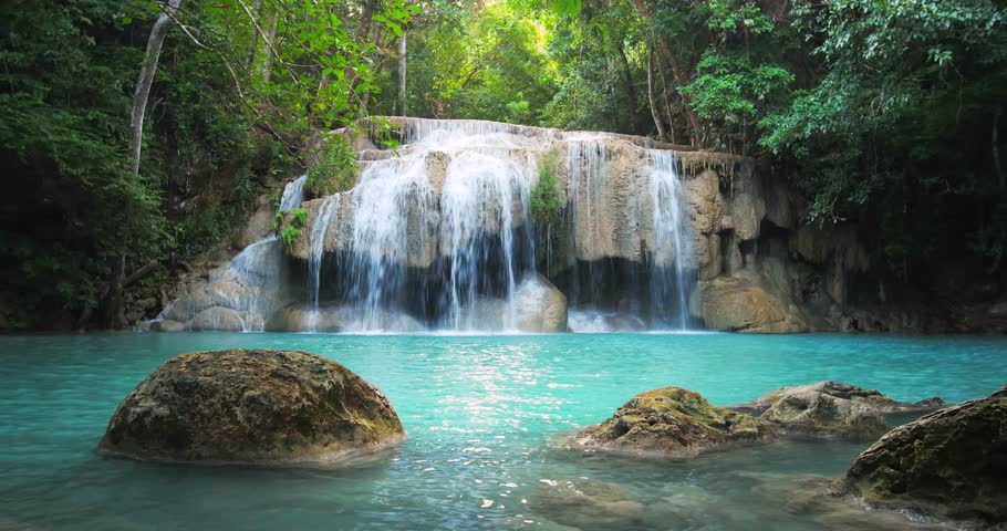 Scenic waterfall in Thailand tropical forest. Beautiful nature loopable seamless background | Shutterstock HD Video #10555079