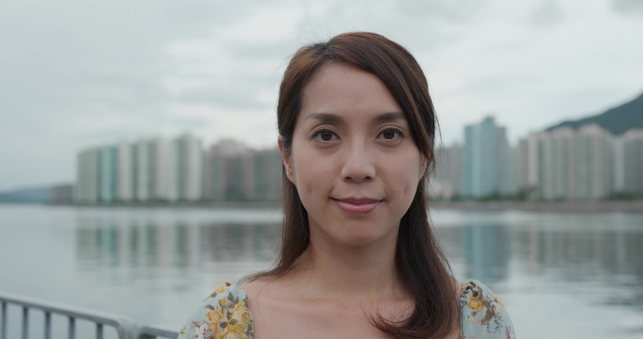 Woman smile to camera in city | Shutterstock HD Video #1055512514
