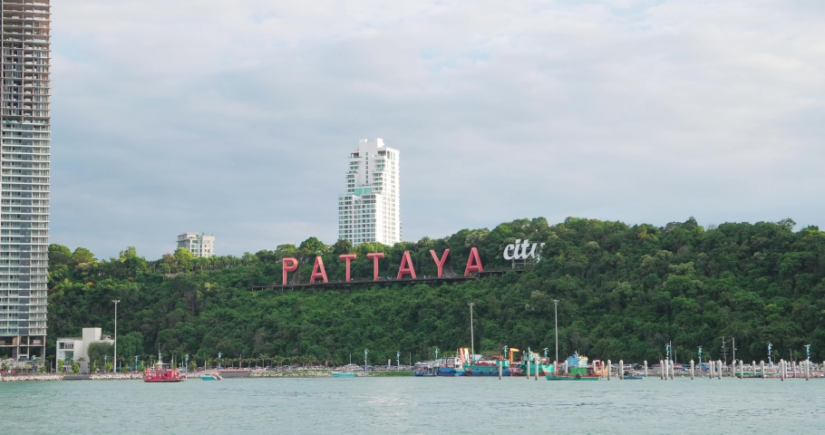 The famous Pattaya city sign on the hill at Bali Hai Pier in Chonburi. Pattaya is famous city for beaches, tourist destinations and nightlife. Royalty-Free Stock Footage #1055521229