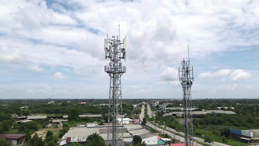 Aerial view shot around of telecommunication tower in a rural location.tower antennas for wireless 3G, 4G or 5G mobile phone networks and telecom internet communication | Shutterstock HD Video #1055526134