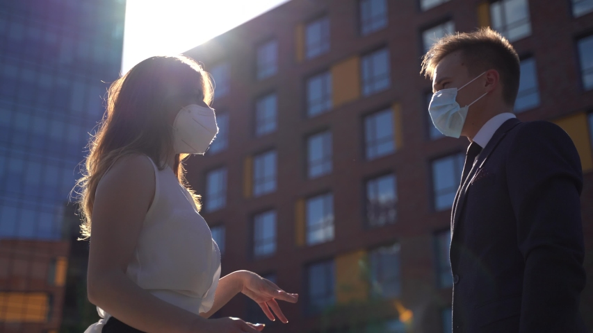 caucasian businesswomen and businessman wear medical face masks greeting with elbow bump. Two colleagues avoid touch for coronavirus protection covid 19 spreading prevention. Royalty-Free Stock Footage #1055527271
