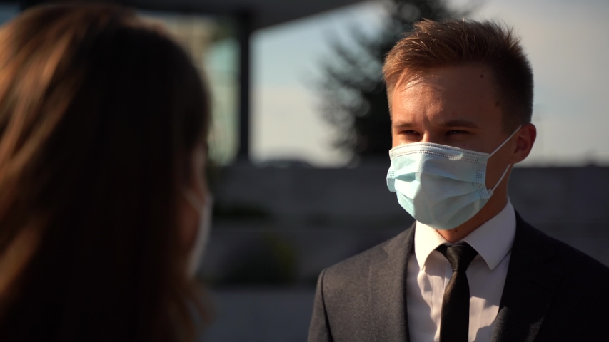 european businessman wear medical face masks. Two colleagues avoid touch for coronavirus protection covid 19 spreading prevention. Royalty-Free Stock Footage #1055527289
