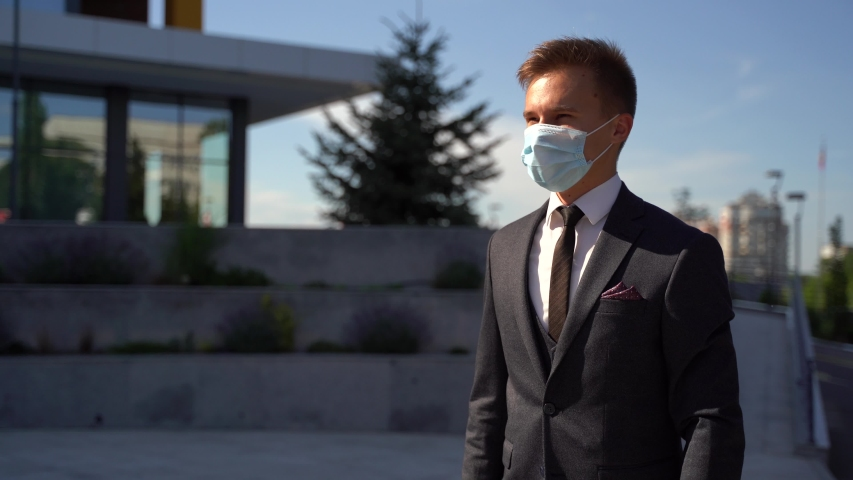 caucasian businesswomen and businessman wear medical face masks greeting with elbow bump. Two colleagues avoid touch for coronavirus protection covid 19 spreading prevention. Royalty-Free Stock Footage #1055527295