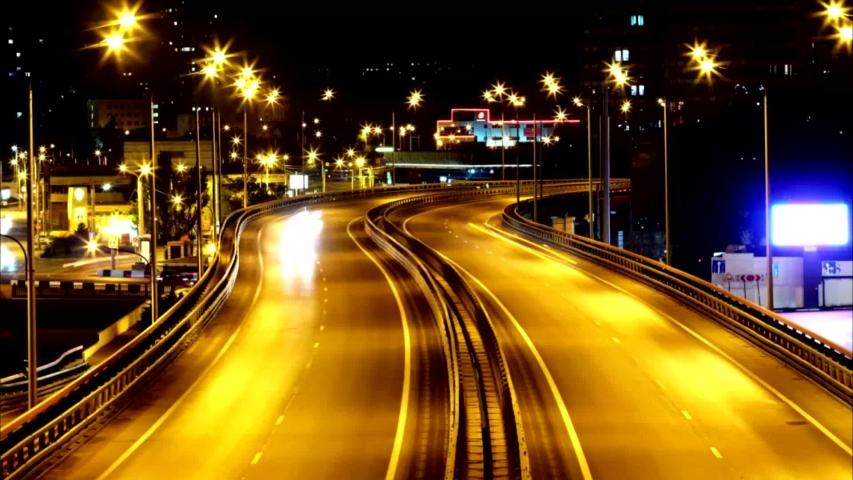 Time lapse of the night city, the movement of cars. | Shutterstock HD Video #1055538089