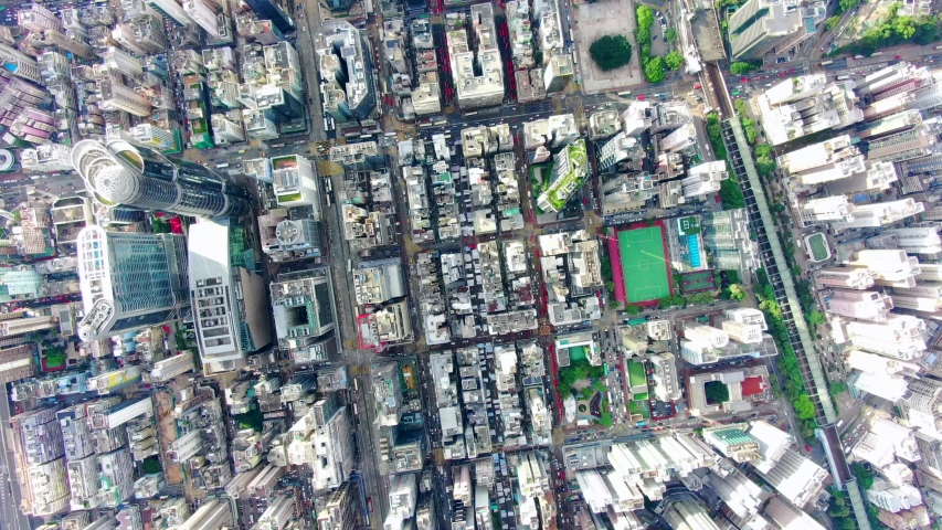 Hong Kong Urban cityscape with buildings and traffic, High altitude aerial view. | Shutterstock HD Video #1055543621