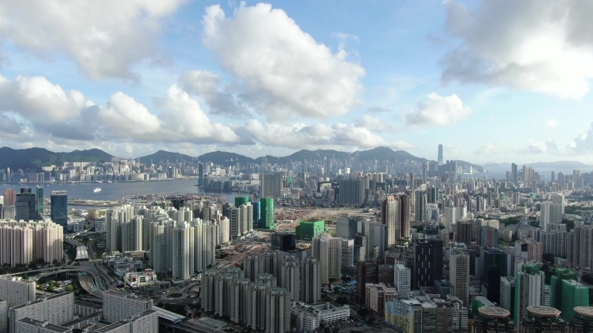 Hong Kong Urban cityscape with buildings and traffic above Kowloon, High altitude aerial view. | Shutterstock HD Video #1055543624