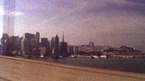 2019: Retro looking footage filmed on Super 8 old looking footage of San Francisco skyline while driving across Golden Gate Bridge