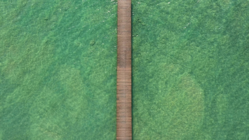 Slow flying over a wooden pier top view | Shutterstock HD Video #1055552225