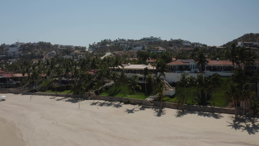 Cabo San Lucas hotel front. Aerial view looking at the resorts on the beach. Drone tracks along the beach.  | Shutterstock HD Video #1055552837