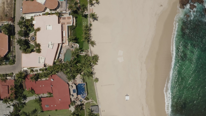 Top down aerial view of Cabo San Lucas resort and the beach. Where the land meets the sea.  | Shutterstock HD Video #1055553200