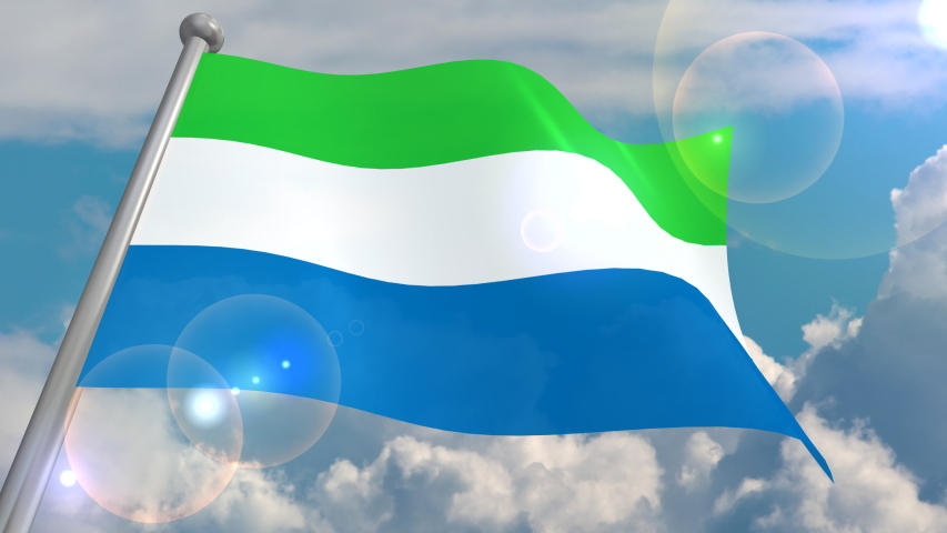 The flag of the state of Sierra Leone flies in the wind against a blue sky with cumulus clouds and a flash on the lens from the sun. 4K video is looped and decoded from a 3D program. | Shutterstock HD Video #1055555051